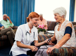 old woman and a nurse smiling
