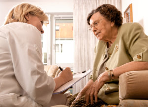 senior woman is visited by her doctor
